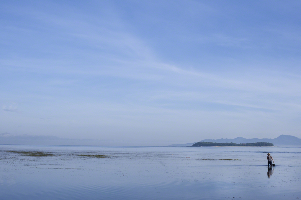 Lombok, Sekotong zonsopgang man in zee saarshot